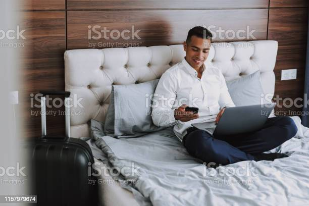 Cheerful man is using modern technologies in hotel room picture id1157979674?b=1&k=6&m=1157979674&s=612x612&h=twm7s3iozx5wmdc96 1chqegqxq nzxvb4wim5rx w0=