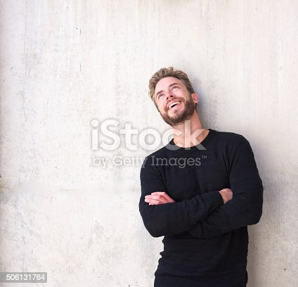 istock Cheerful man laughing and looking up 506131764