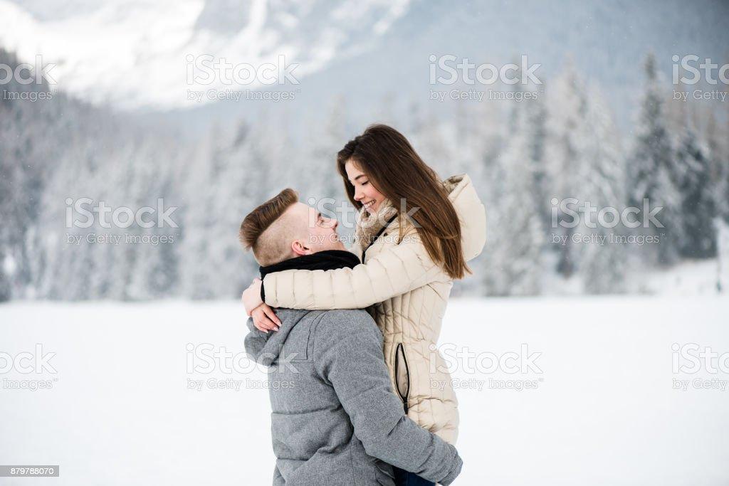 Cheerful man lifting up his girlfriend stock photo