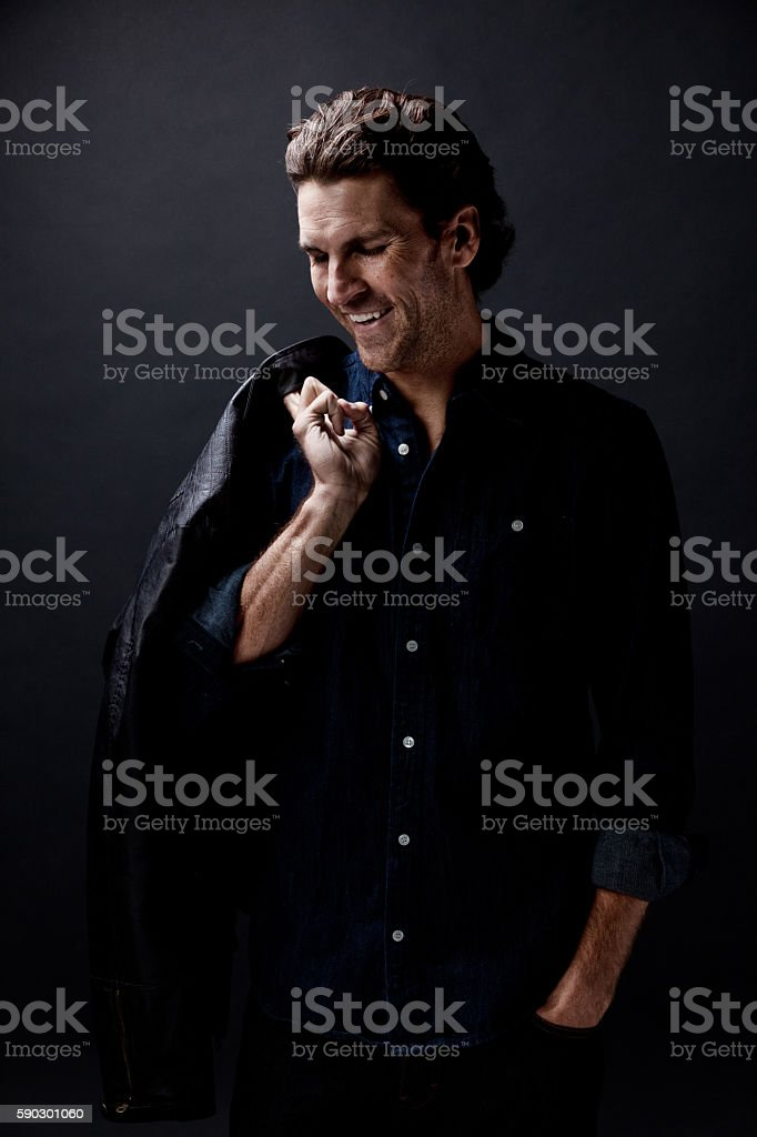 Cheerful man looking down royaltyfri bildbanksbilder