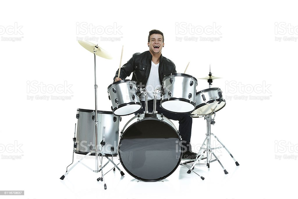 Cheerful man playing drums stock photo