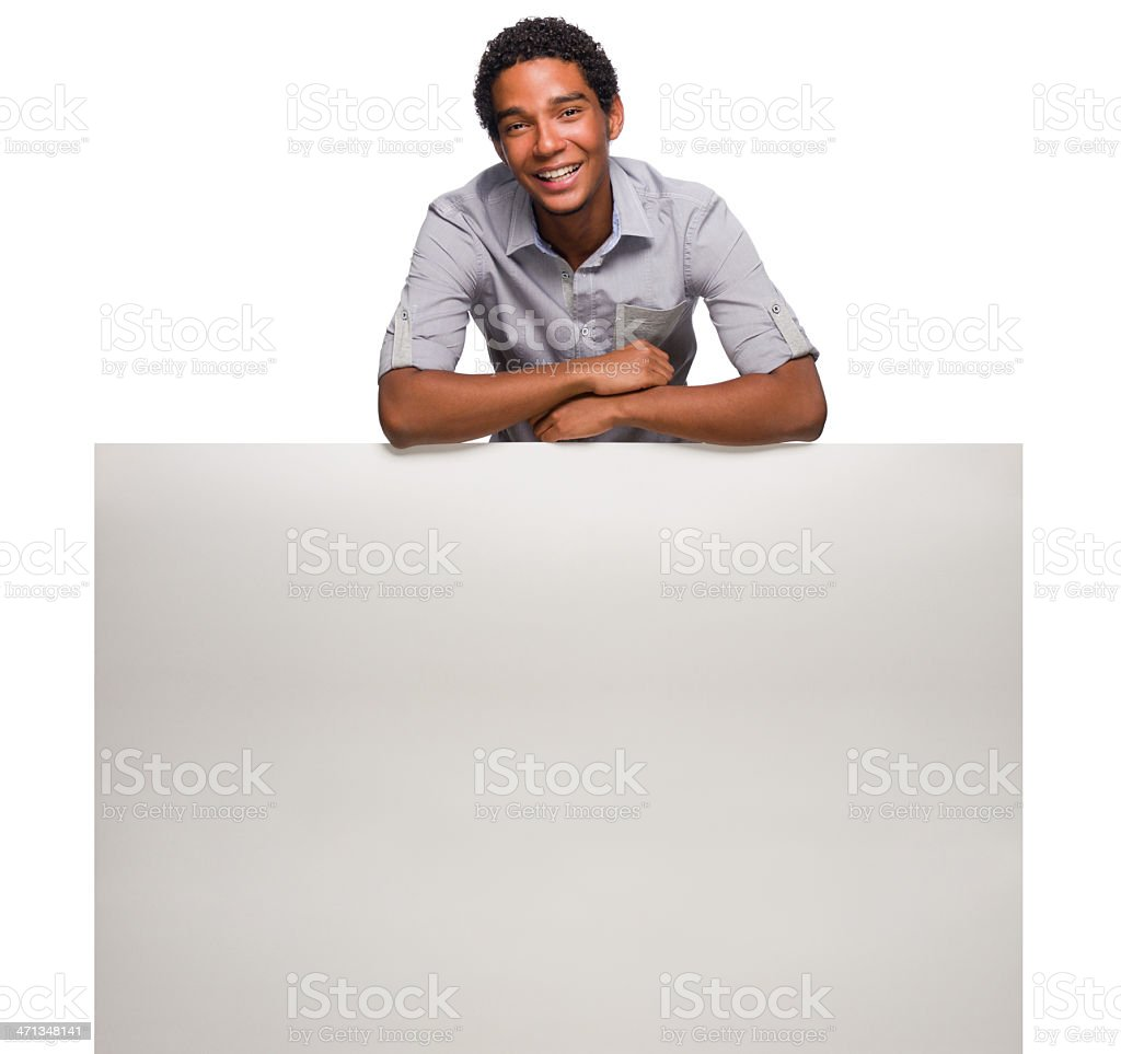Cheerful man posing with a billboard royalty-free stock photo