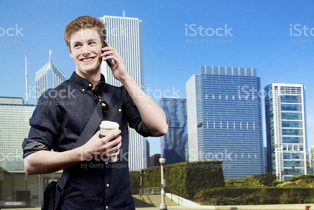 Cheerful man talking on mobile with coffee cup royalty-free stock photo