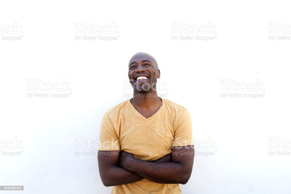 Cheerful man with arms crossed stock photo