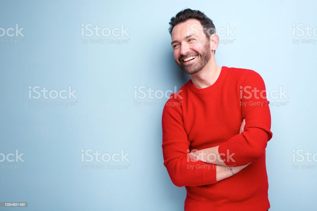 cheerful man with beard laughing against blue background - Zbiór zdjęć royalty-free (30-34 lata)