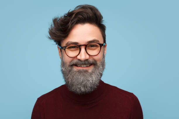 cheerful man with glittering beard - hipster persona foto e immagini stock