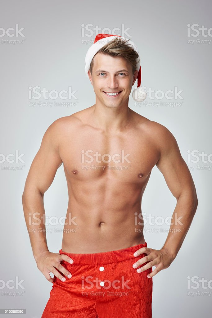 Cheerful man with hands on hips stock photo