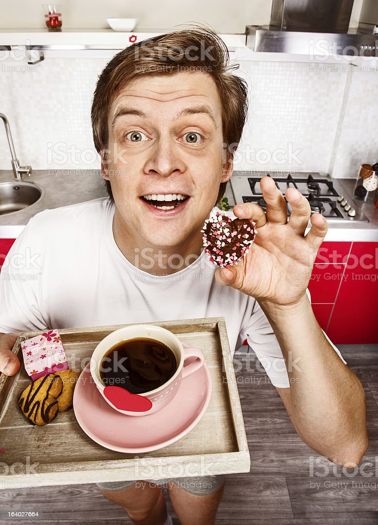 Cheerful man  with morning coffee and cookies royalty-free stock photo