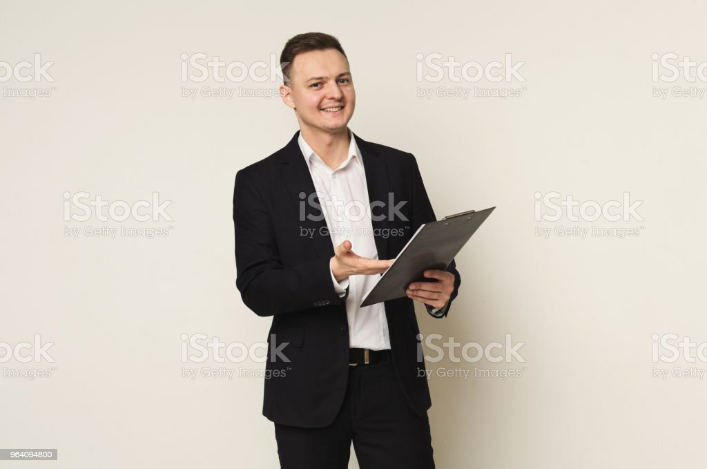 Cheerful man with notepad on white background - Royalty-free Adult Stock Photo