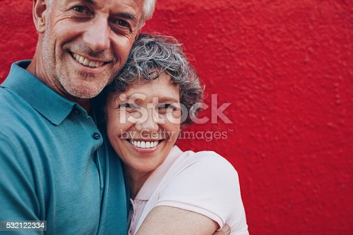 529076288 istock photo Cheerful mature couple embracing each other 532122334