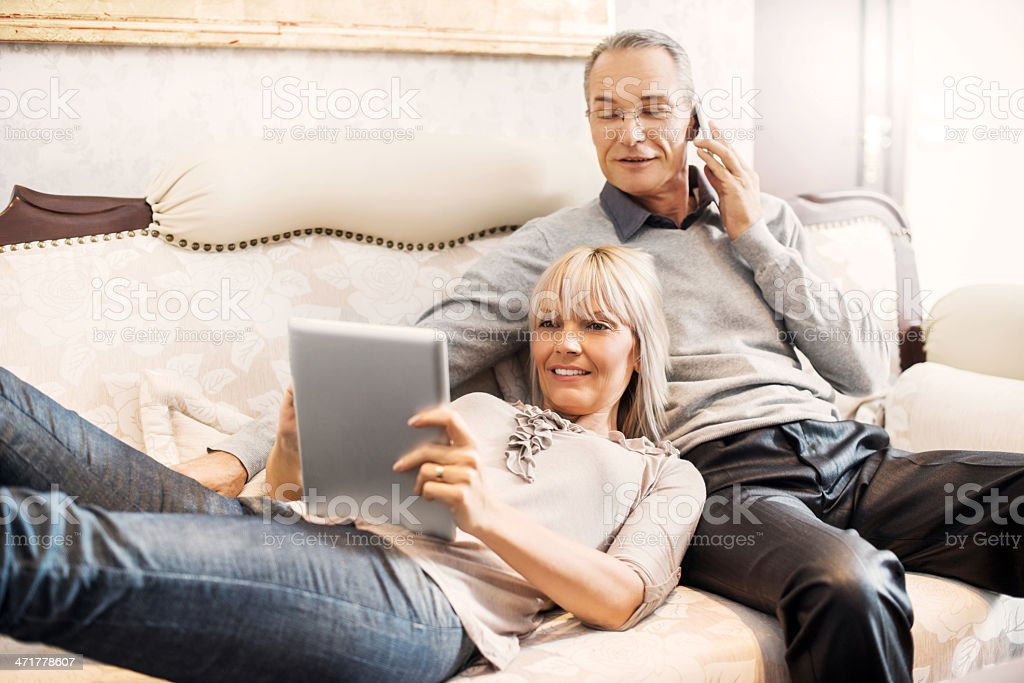 Cheerful mature couple relaxing at home. royalty-free stock photo