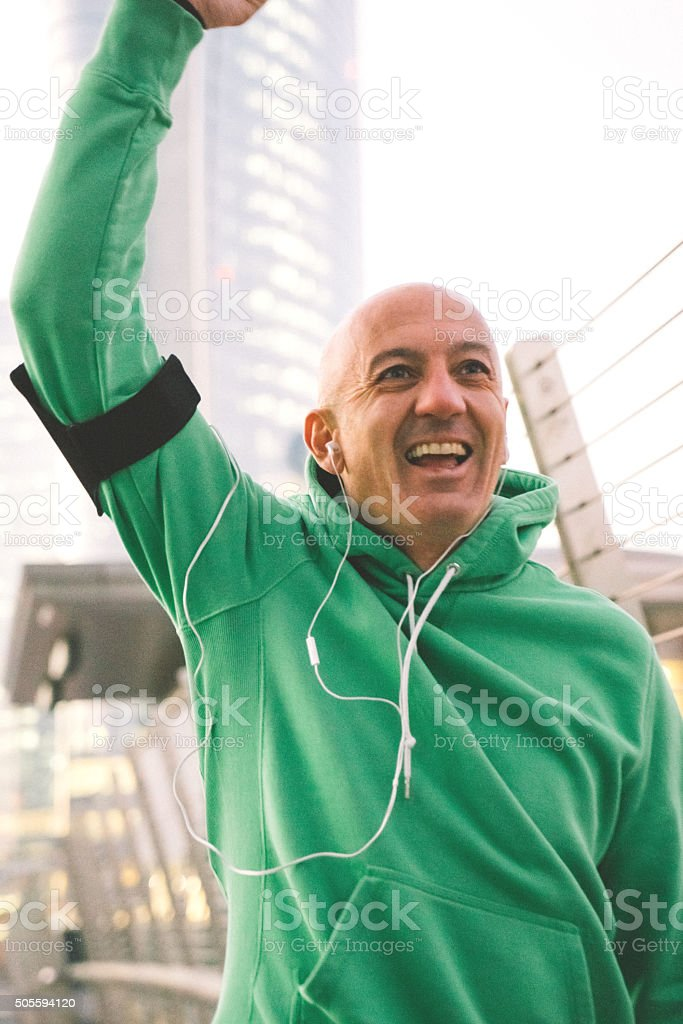 Cheerful Mature Man Running Outdoors Wearing Sport Clothes stock photo