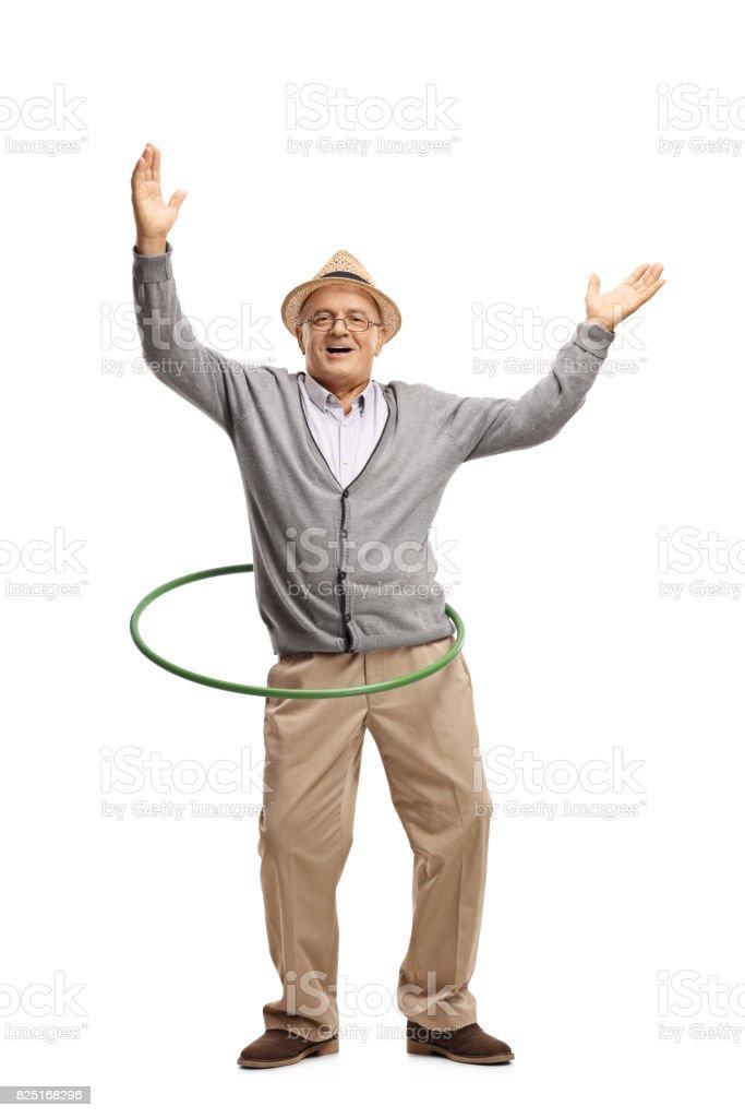 Cheerful mature man with a hula hoop stock photo