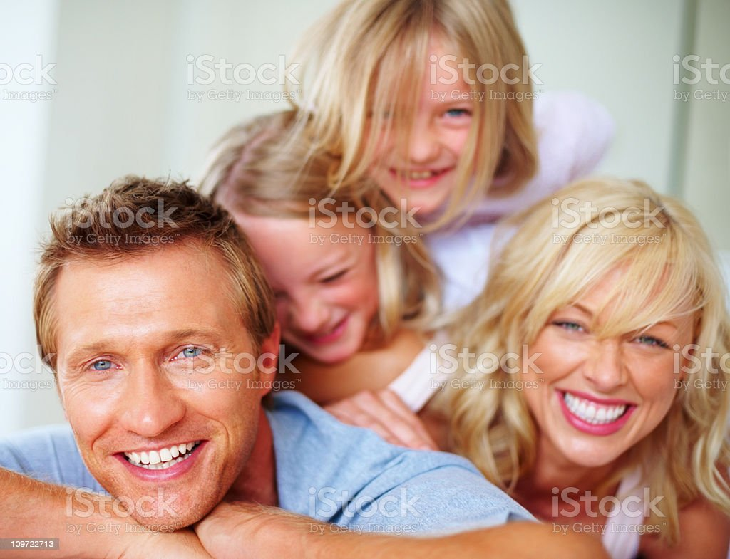 Cheerful mature man with his family having fun together royalty-free stock photo