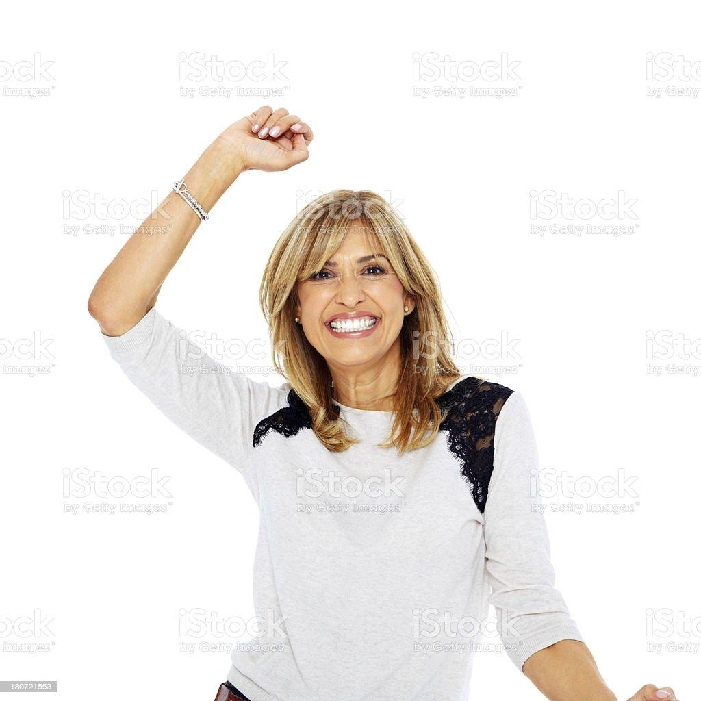Cheerful mature woman celebrating success royalty-free stock photo