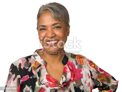 1173001813istockphoto Cheerful mature woman in floral top posing for a portrait 174854066