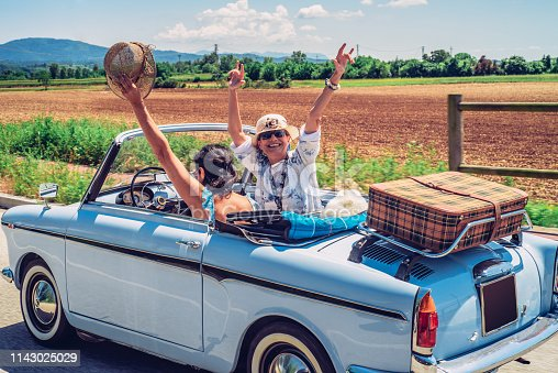 Cheerful Mature Women Enjoying on a Road Trip.