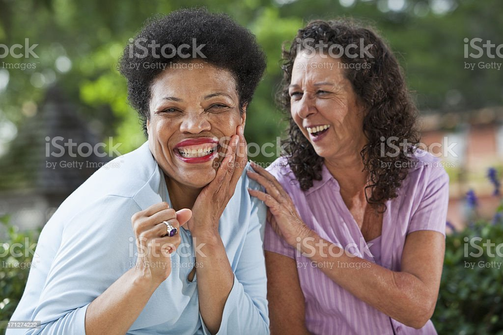 Cheerful mature women stock photo