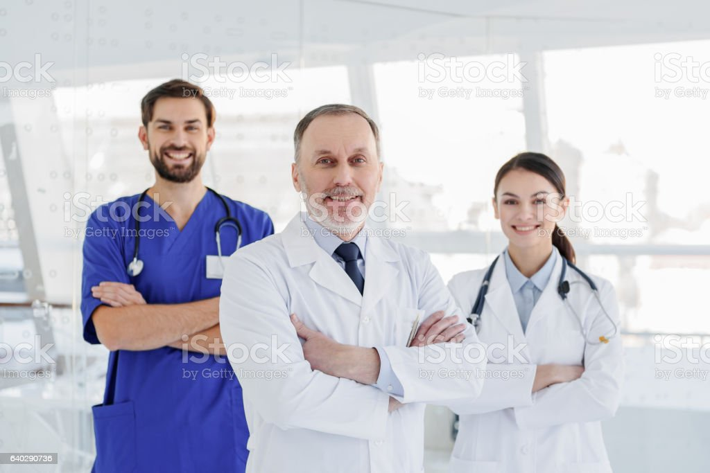 Cheerful medical team posing with confidence stock photo