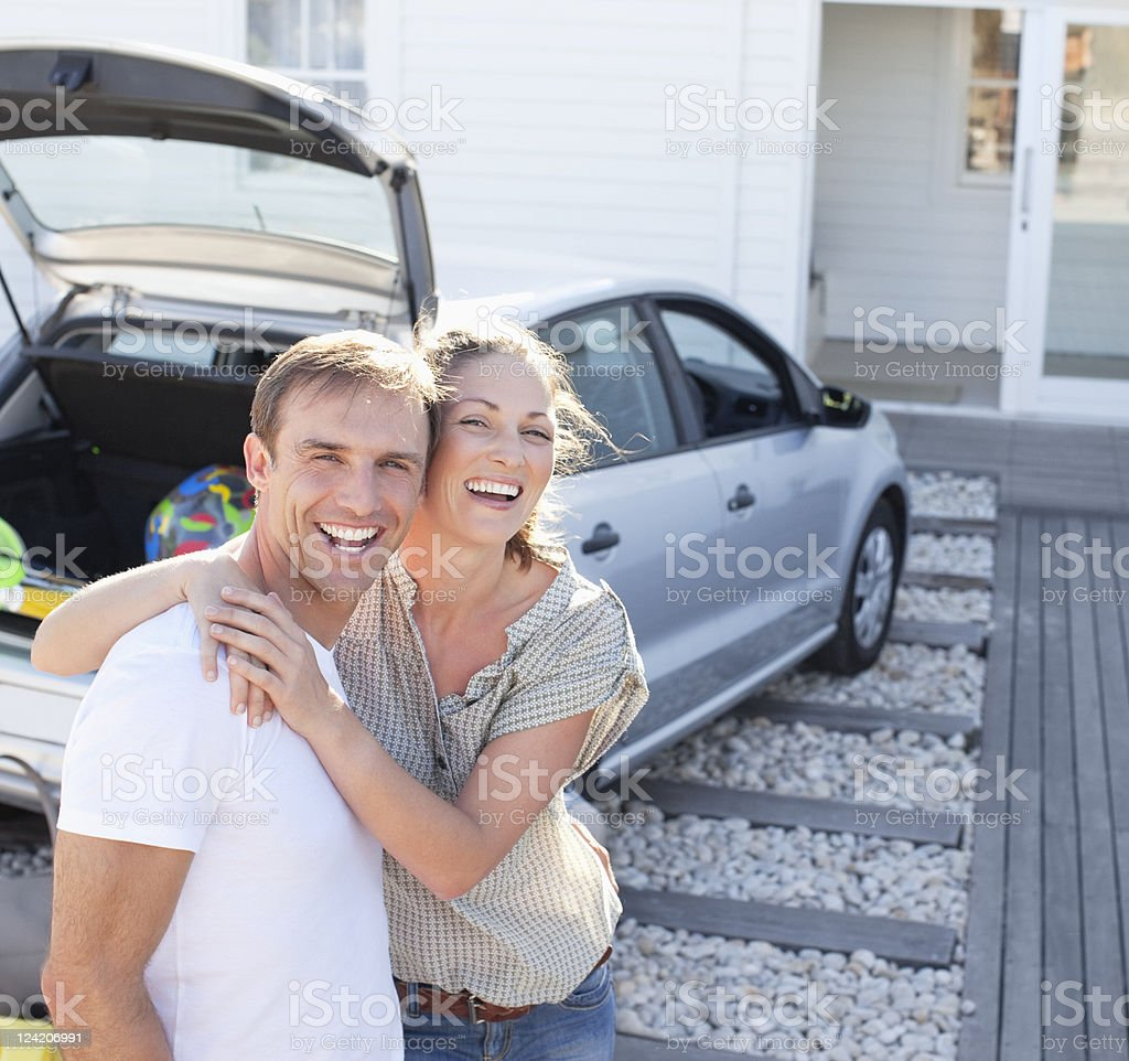 Cheerful mid adult couple embracing on vacation royalty-free stock photo