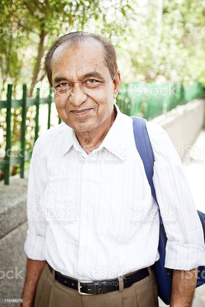 Cheerful Middle Class Indian Senior Man with Shoulder Bag royalty-free stock photo