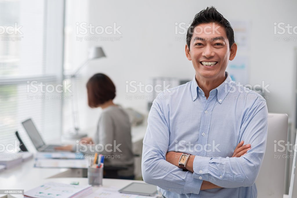 Cheerful middle-aged businessman stock photo