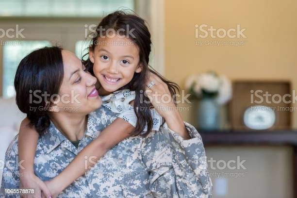 Cheerful military mom is reunited with adorable daughter picture id1065578878?b=1&k=6&m=1065578878&s=612x612&h=axtyn u3kqb8x0tzrm9nggobkmmlmrj2zto tscrle8=