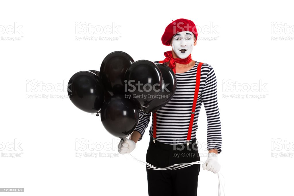 cheerful mime holding bundle of balloons with helium isolated on white stock photo