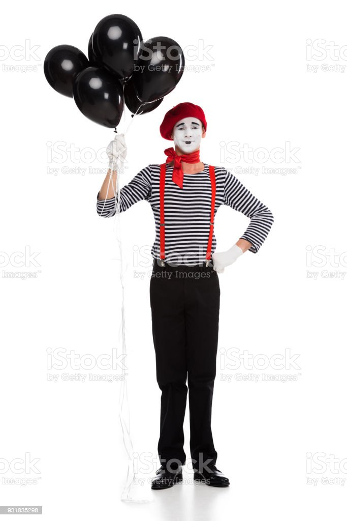 cheerful mime holding bundle of black balloons with helium isolated on white stock photo