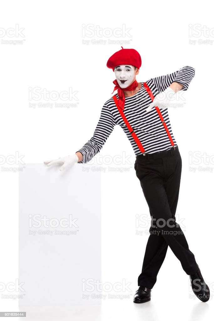 cheerful mime pointing on empty board isolated on white stock photo
