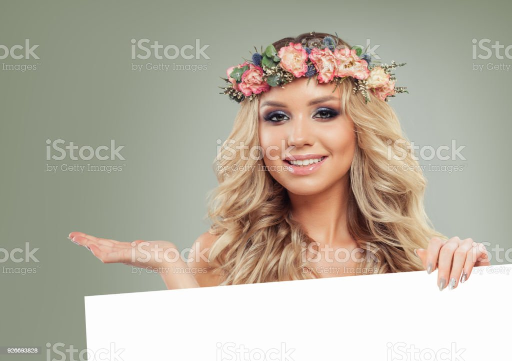 Cheerful Model with Blank Board Banner Background. Beautiful Woman holding White Paper stock photo
