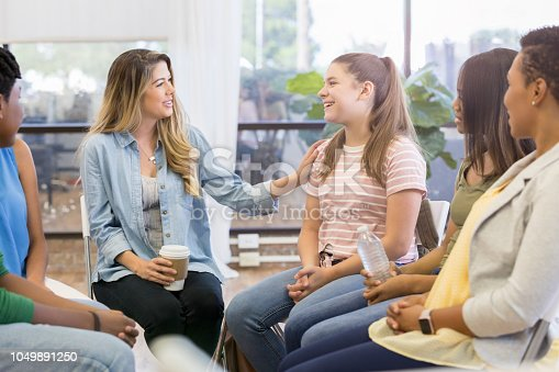 1055095320 istock photo Cheerful mom and daughter during support group 1049891250
