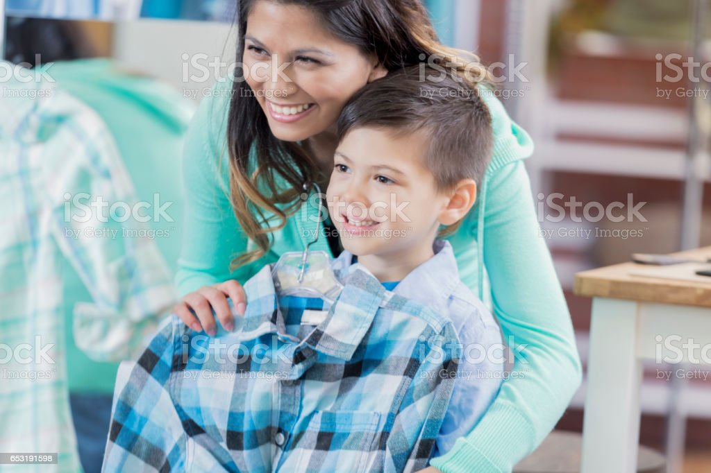 Cheerful mom shops with young son stock photo