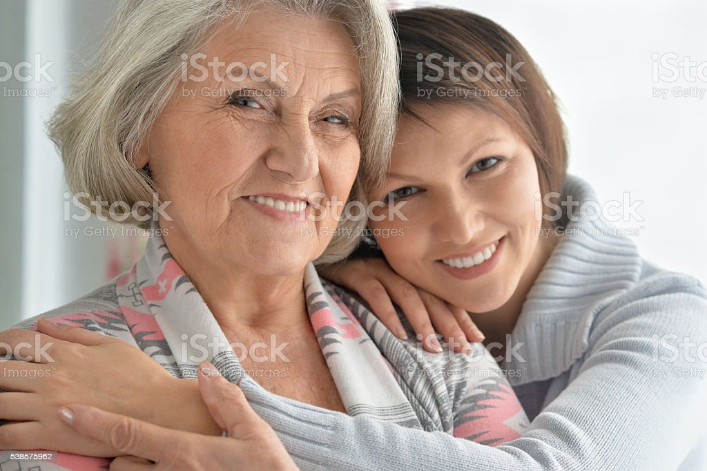 cheerful mother and adult daughter stock photo