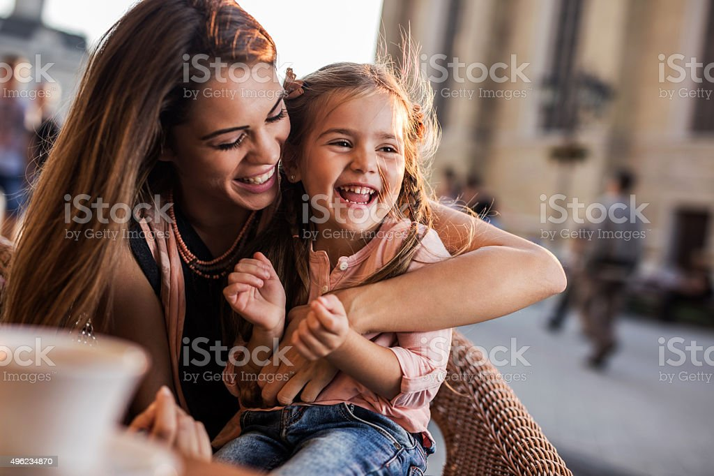 Cheerful mother and daughter having fun together during the day. stock photo