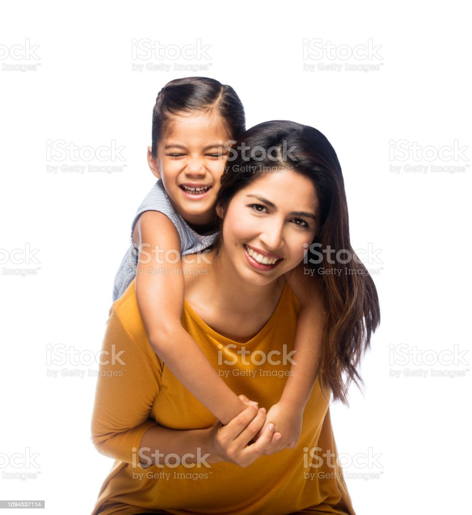 Cheerful mother and daughter stock photo