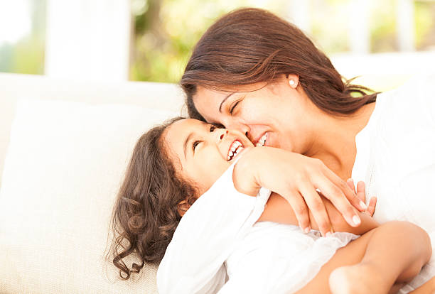 Cheerful Mother And Daughter Playing Around stock photo