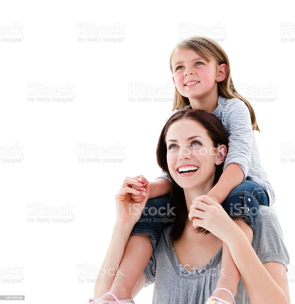 Cheerful mother giving piggyback ride to her daughter royalty-free stock photo