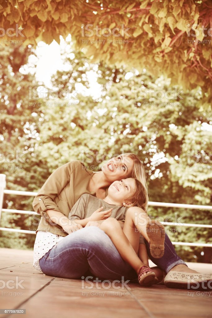 Cheerful mother with her daughter outdoor. royalty-free stock photo