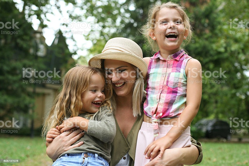 Cheerful mother with her kids having fun outdoor. – Foto