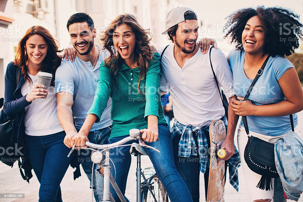 Cheerful multi-ethnic group of young people stock photo