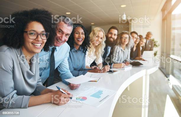 Cheerful Multiracial Colleagues Looking At Camera In Office Stock Photo - Download Image Now