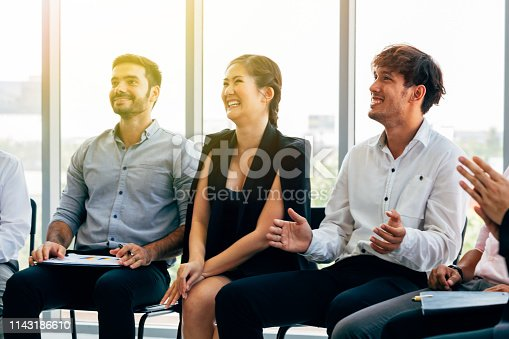 858148040 istock photo Cheerful multiracial colleagues on conference 1143186610