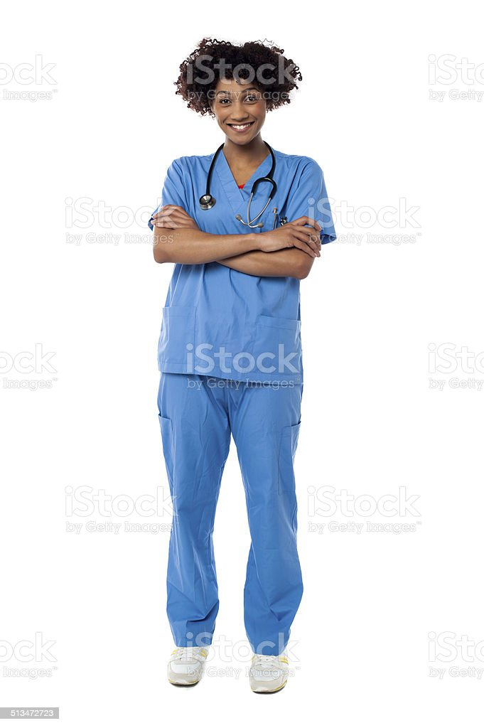 Cheerful nurse posing with arms crossed royalty-free stock photo