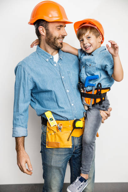 Cheerful parent with kid during flat repairing stock photo stock photo