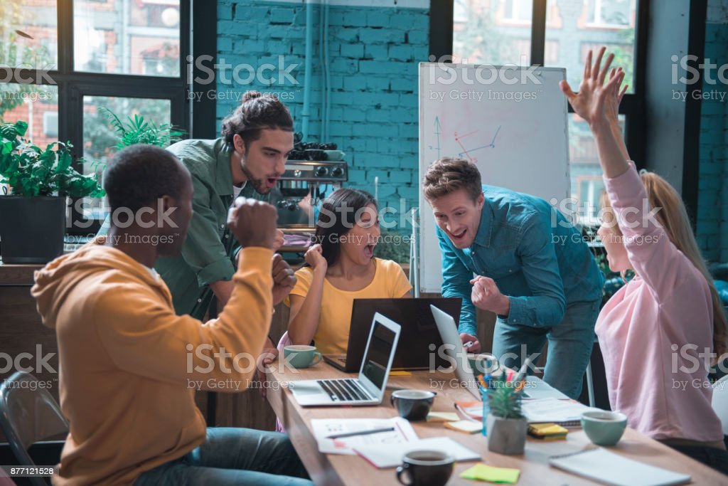 Cheerful partners gesturing hands in office royalty-free stock photo