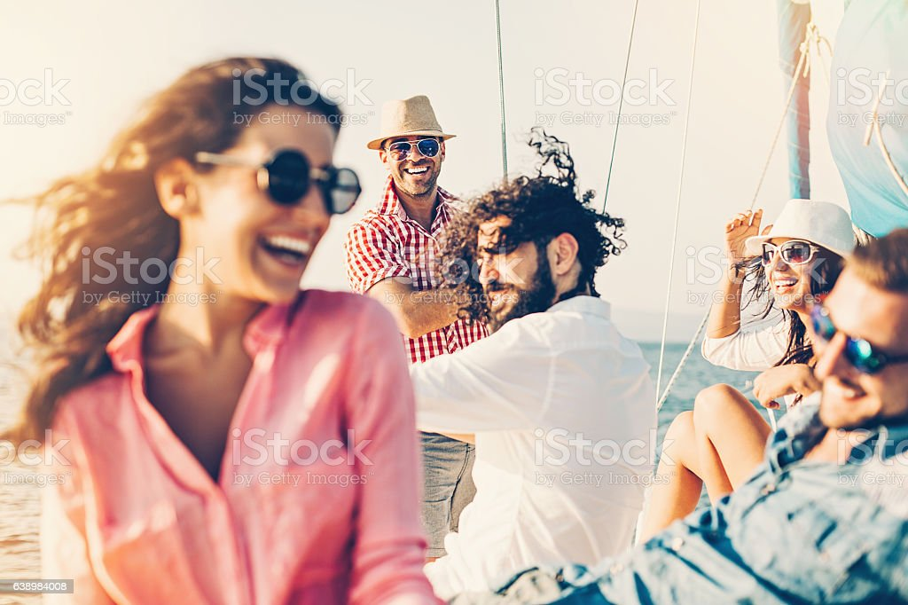 Cheerful people on a yacht - foto de stock