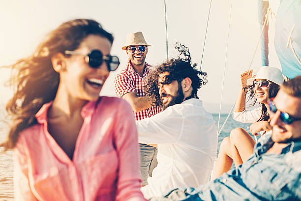Cheerful people on a yacht - fotografia de stock