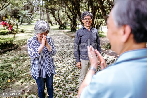 646614234 istock photo Cheerful people with teacher of Tai Chi outdoor 1191749915