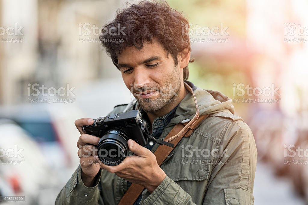 Cheerful photographer in the street stock photo
